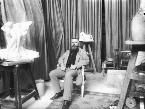 dornac-auguste-rodin-1840-1917-seated-beside-the-sculpture-le-printemps-eternal-spring-in-his-studio