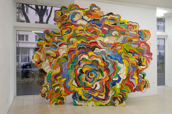 artist uses recycled books to create large sculpture