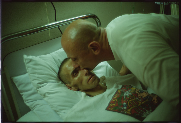 "Famous for intimately photographing her friends, Nan Goldin unabashedly gave face to the victims of the AIDS crisis in her work as pictured here in ""Gostcho kissing Gilles"" (1993)."