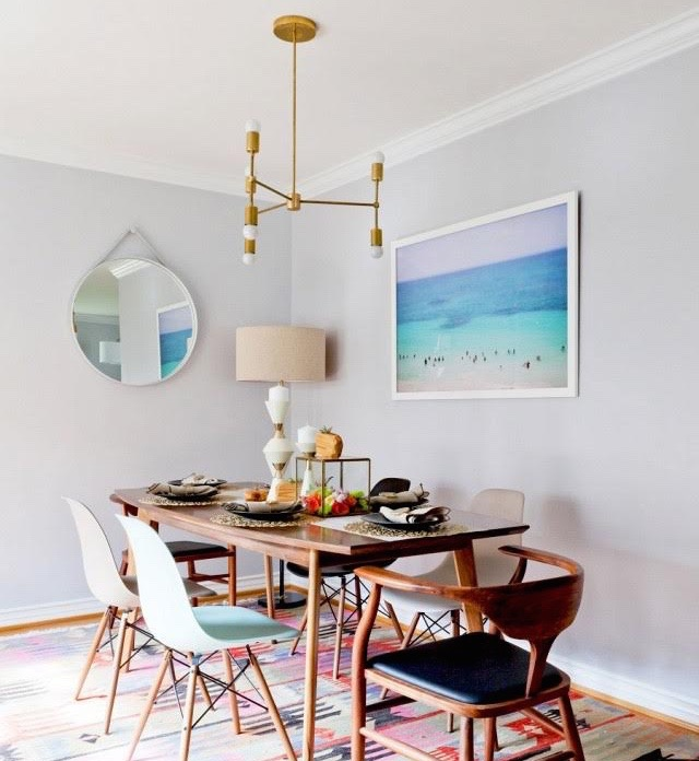 dean west's tranquil beach photography hangs in this dining room