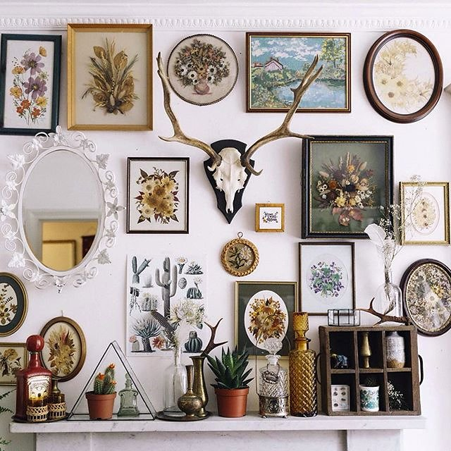mix textures and dimensions to create a dynamic gallery wall
