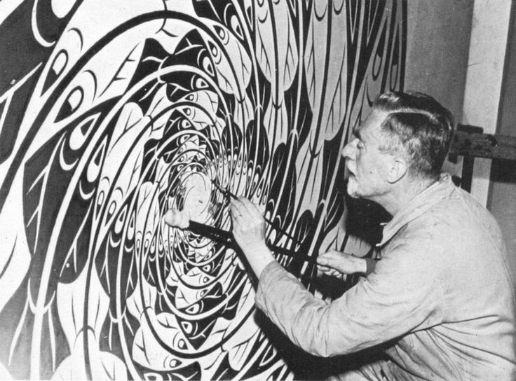 Escher at work in his studio making a tessalation