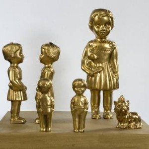 small gold children and dog sculpture multiple pieces