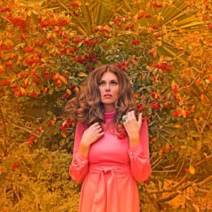 70s glam photography of woman pink and red stephanie vovas
